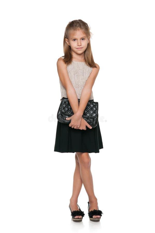 有提包的时尚女孩 免版税图库摄影