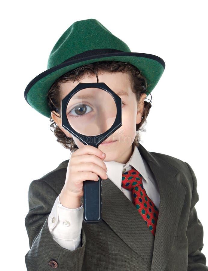 有放大镜的小探员 库存照片