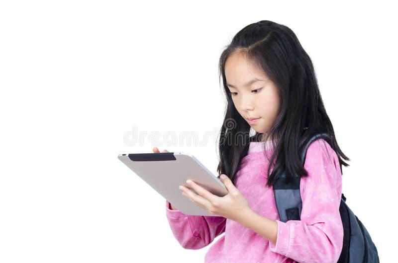 有数字式片剂的少年女孩 库存照片