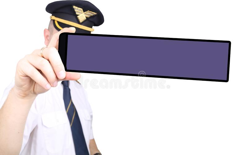 有数字电话的航空公司飞行员 库存图片