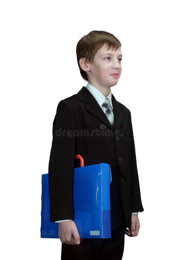 有文件夹的聪明的男小学生 库存照片