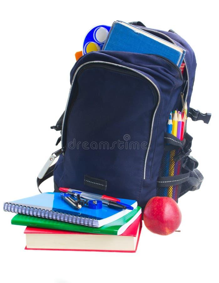 有文具的学校背包 免版税库存照片