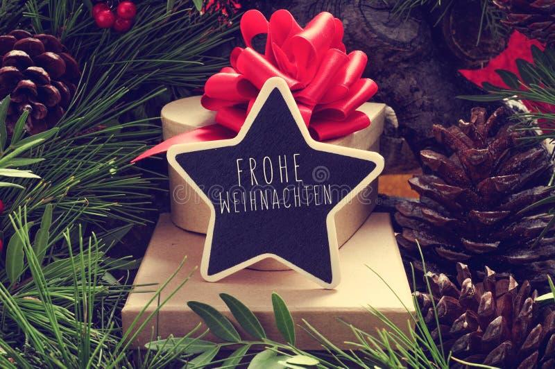 有文本的Frohe Weihnachten,快活的Ch星状黑板 免版税库存图片