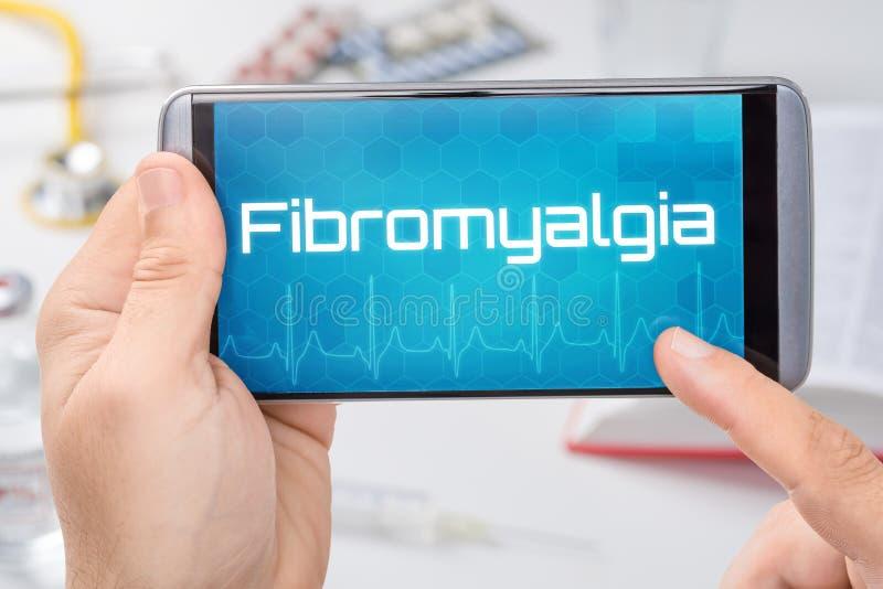 有文本Fibromyalgia的智能手机 库存照片