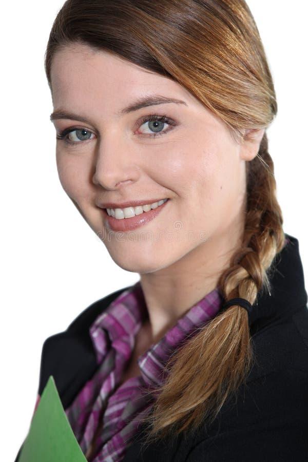 有文件的年轻女实业家。 免版税库存图片