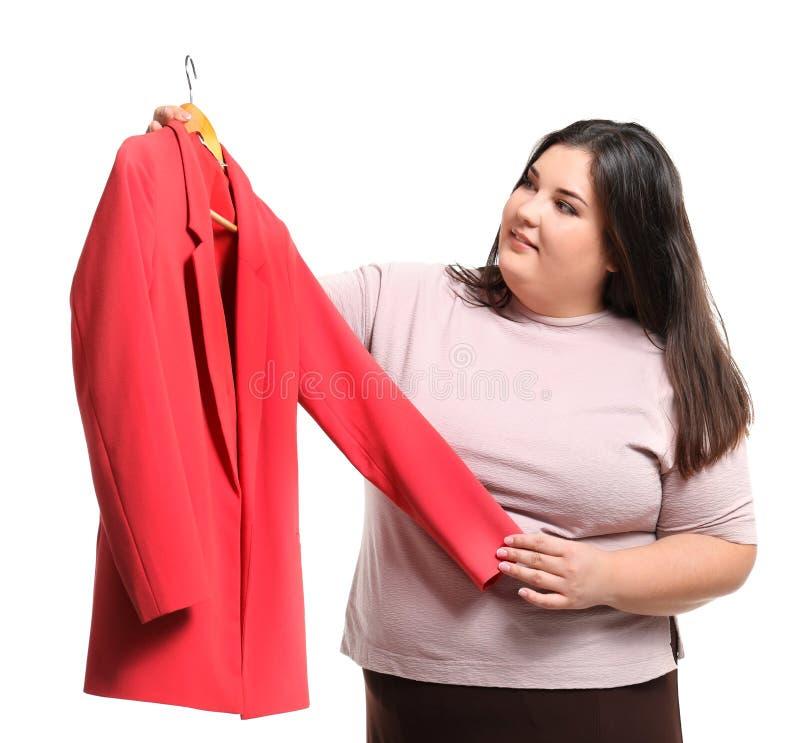 有新的夹克的美丽的超重妇女 库存图片