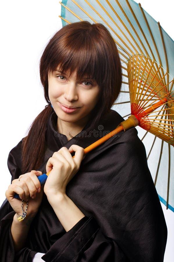 有日本伞的美丽的女孩 免版税库存照片