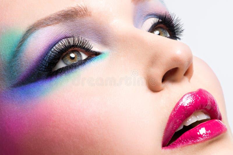 有时尚明亮的构成的美丽的妇女 图库摄影