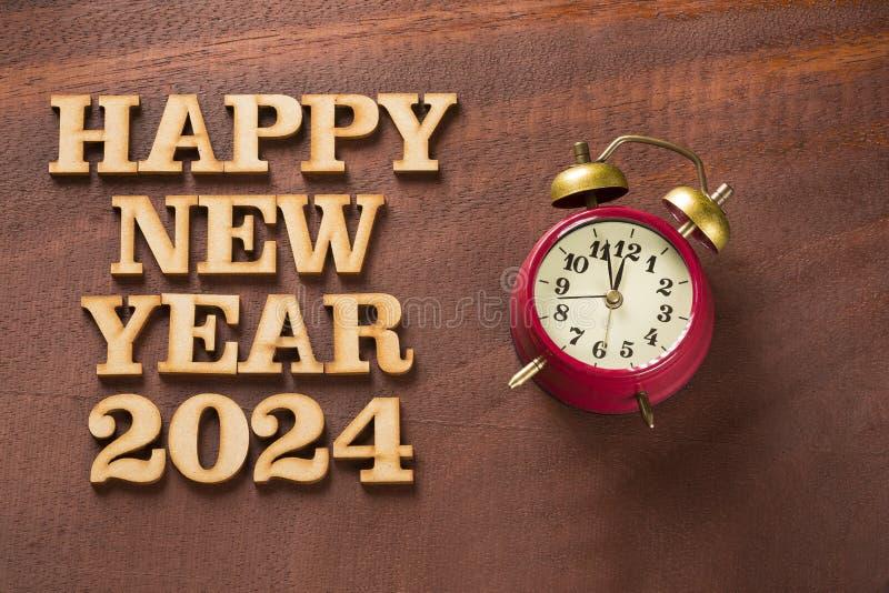 有时钟的新年快乐2024年 库存照片