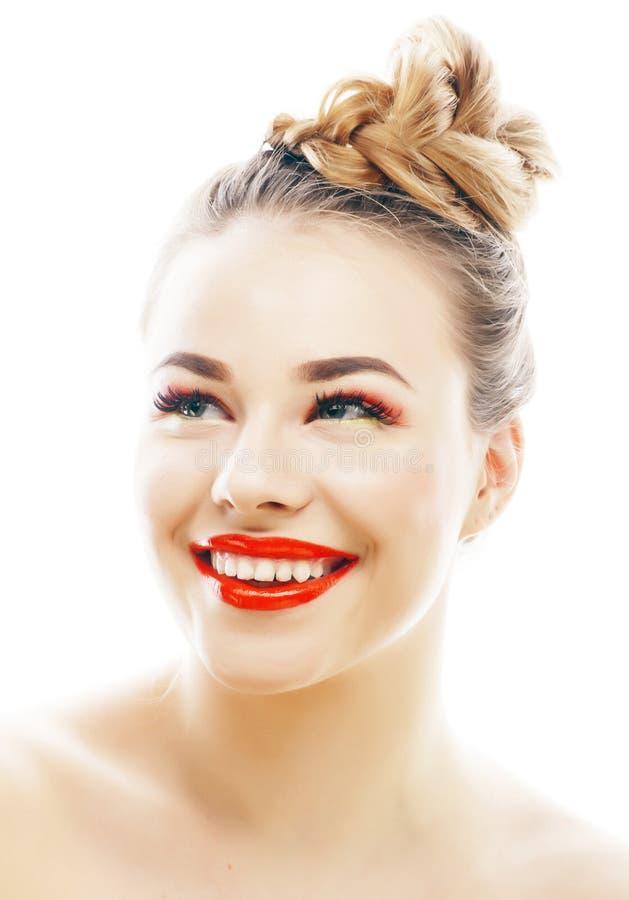 有明亮的年轻白肤金发的妇女在白色提出微笑的观点打手势情感被隔绝象玩偶鞭子,真正 库存照片