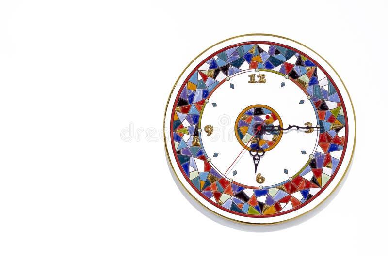 有明亮的样式的陶瓷时钟在白色背景 免版税库存照片