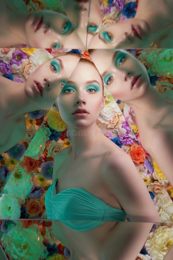 有明亮的colorfull构成的年轻美女在花背景 免版税库存照片