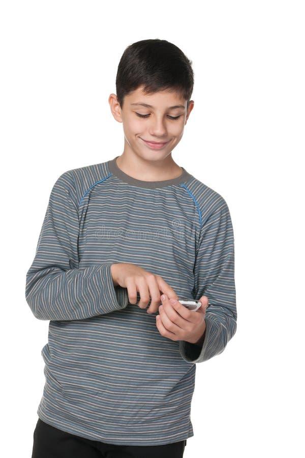 有智能手机的少年 库存照片