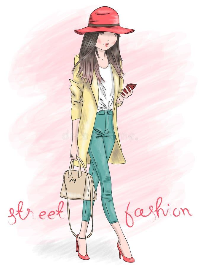 有智能手机的手拉的美丽的逗人喜爱的女孩在与题字街头时尚的背景 皇族释放例证