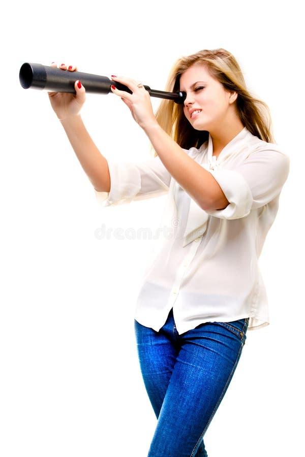 有望远镜的妇女 库存图片