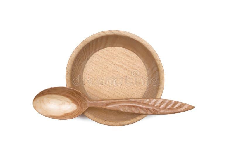 有木匙子的木空的碗板材 库存照片