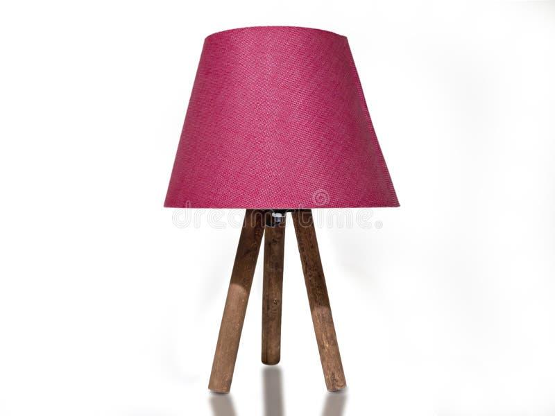 有木腿的桃红色灯罩 桃红色色的夜光 免版税库存图片