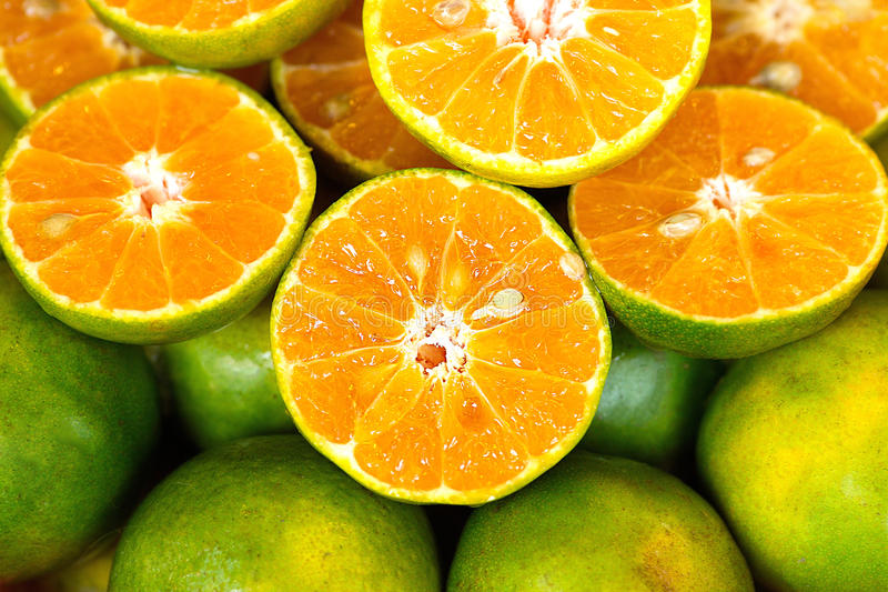 有机新鲜蜜桔泰国食物甜自然橙色绿色的汁液 库存图片