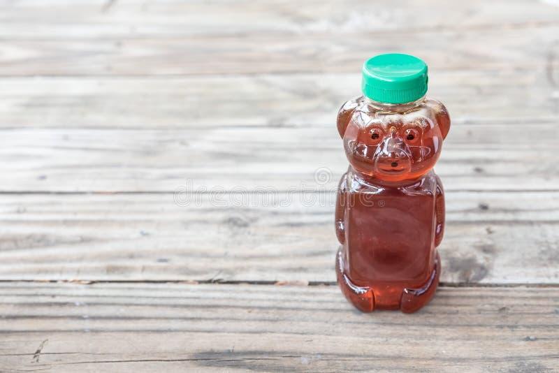 有机自然糖精,蜂蜜,在与室的坚实木背景拷贝的 免版税库存照片