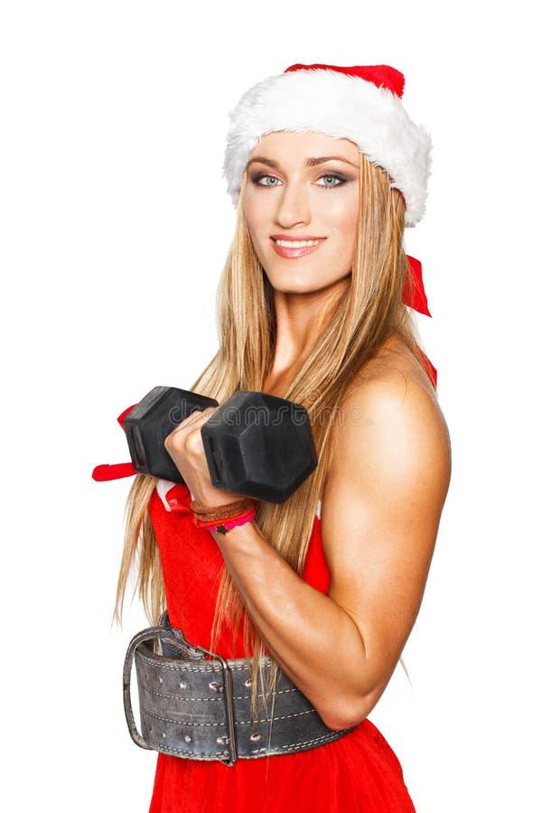 有杠铃的性感的白肤金发的健身妇女 免版税图库摄影