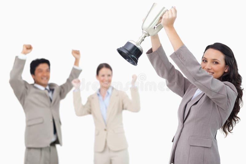 有杯子的成功的女推销员 免版税库存照片