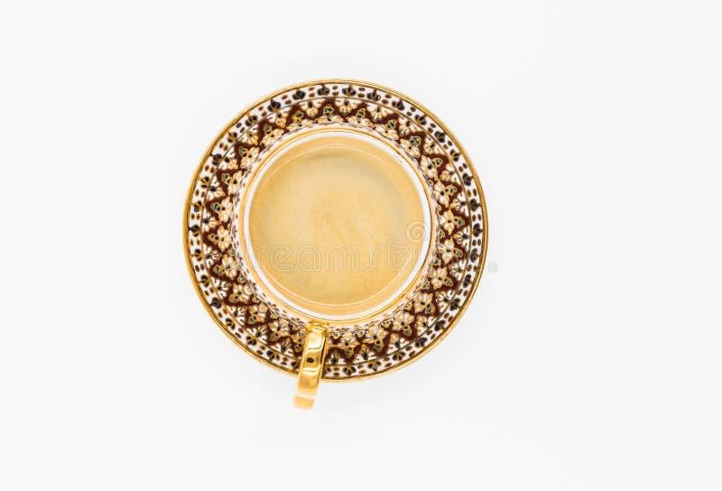 有板材的Flatlay华丽咖啡杯有很多咖啡 免版税库存照片