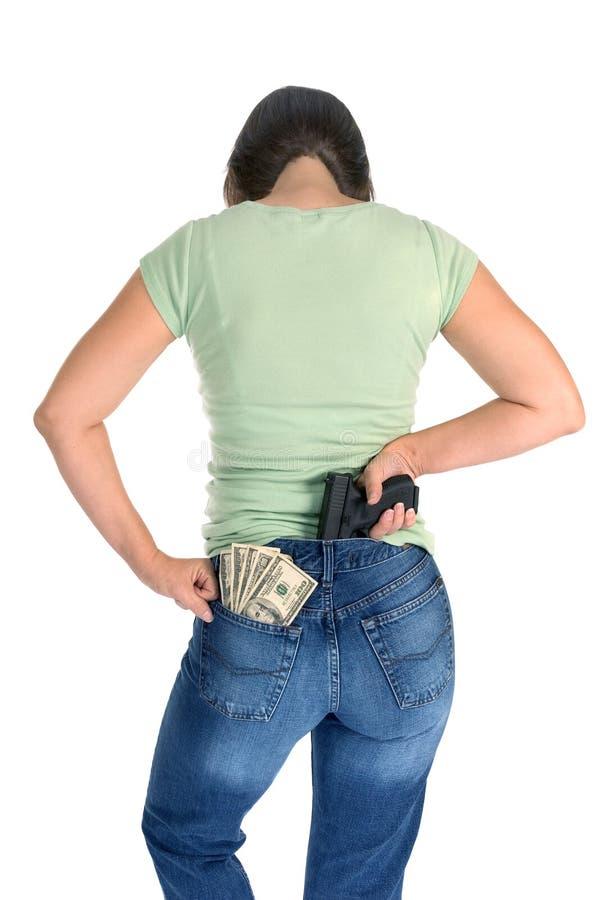 有枪和现金的妇女 免版税库存照片