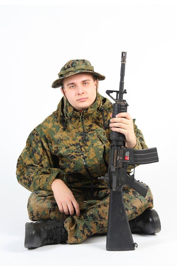 有枪的一位战士 免版税图库摄影