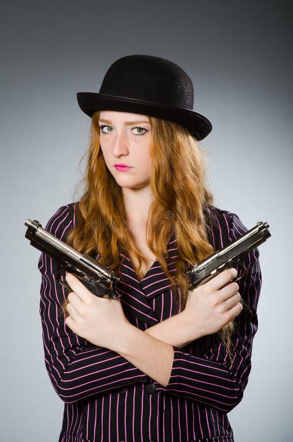 有枪的妇女匪徒 库存图片