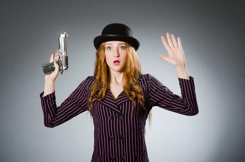有枪的妇女匪徒 图库摄影