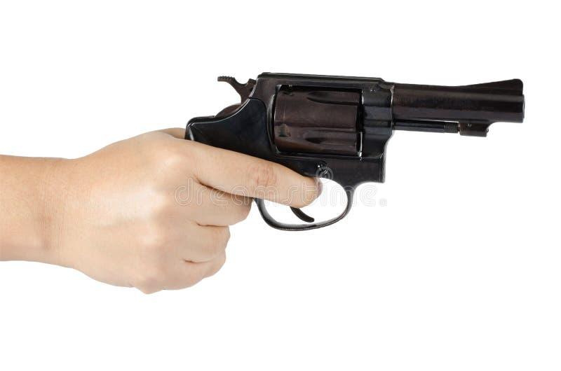有枪的妇女的手 免版税库存图片