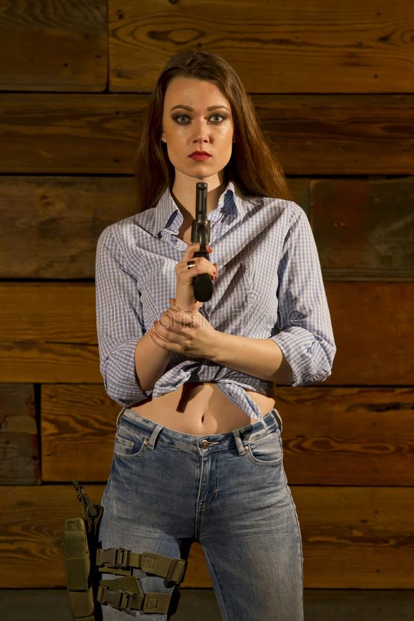 有枪的妇女 库存照片
