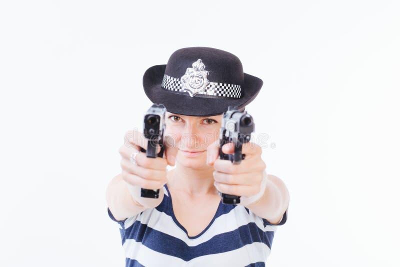 有枪的微笑的妇女 库存照片