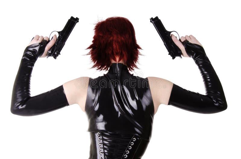 有枪的性感的妇女。 免版税库存照片
