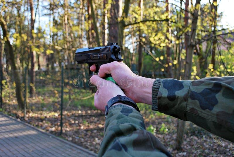 有枪的现有量 库存图片