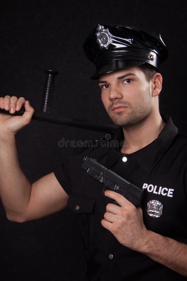 有枪的年轻警察 库存照片