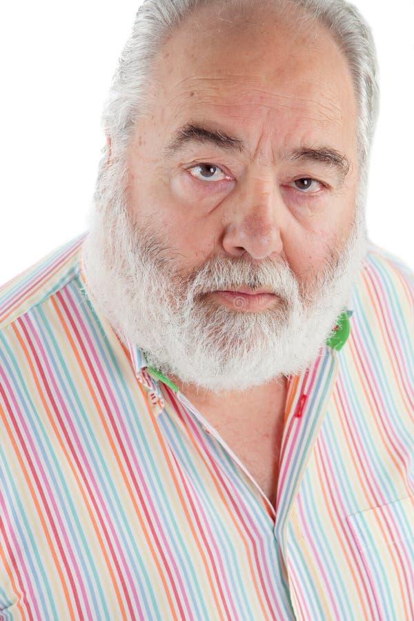 有查寻的白色胡须的老人 库存照片