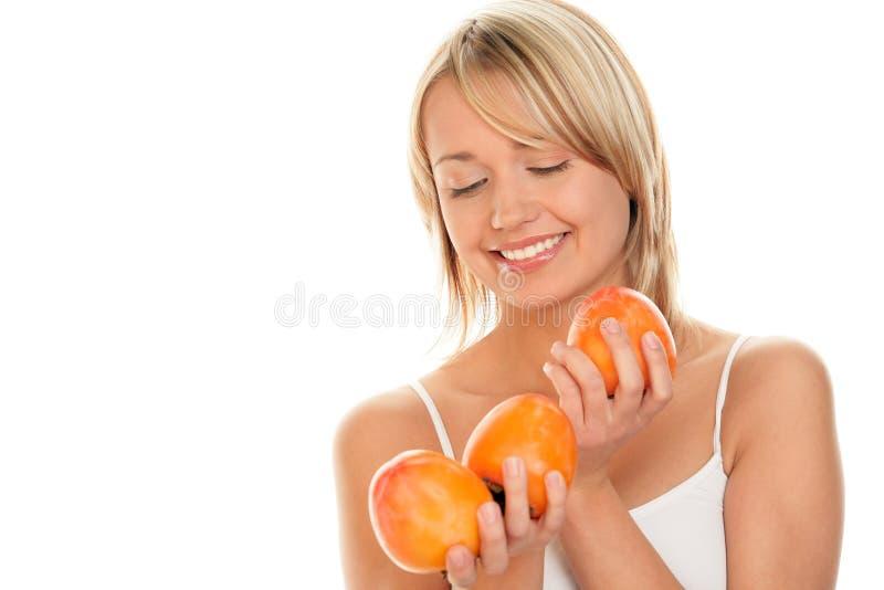 有柿子的妇女 库存照片