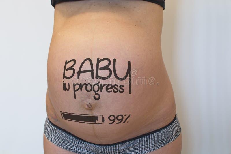 有标志的怀孕的腹部 库存照片