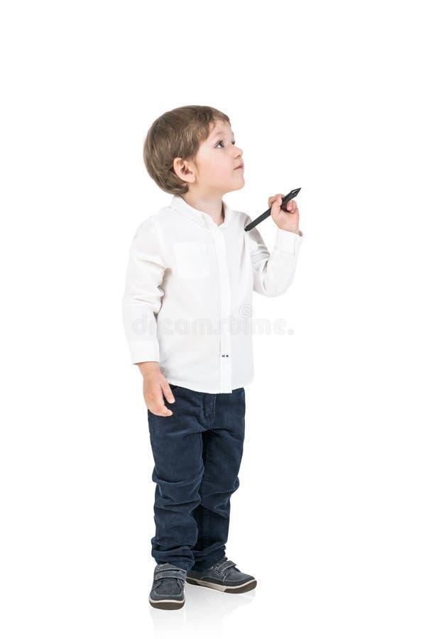 有标志的逗人喜爱的小男孩,被隔绝 库存照片
