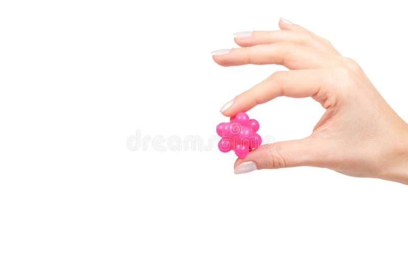 有桃红色尖刻的球的手按摩的,医疗保健概念 免版税库存照片
