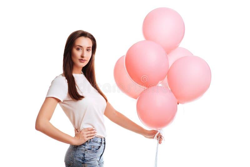 有桃红色气球的女孩 免版税库存照片