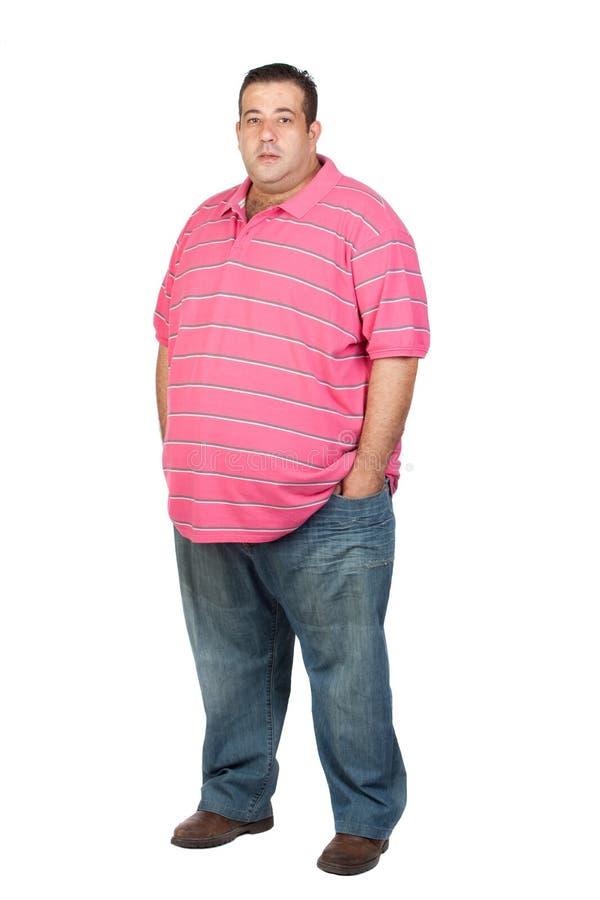 有桃红色衬衣的肥胖人 库存照片