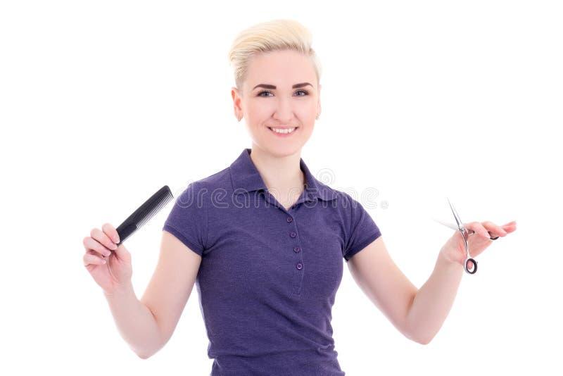 有梳子和剪刀isolat的愉快的美丽的妇女美发师 免版税库存图片