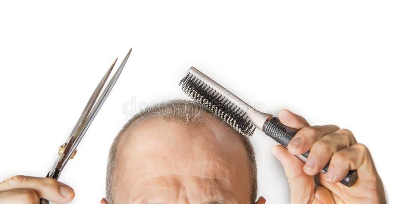 有梳子的秃头人 掉头发概念 库存图片