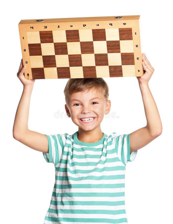 有棋枰的男孩 免版税库存图片