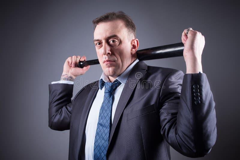 有棒球棒的男性匪徒 免版税库存图片