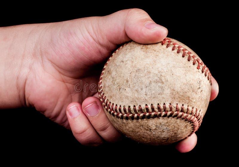 有棒球的男孩 免版税库存照片