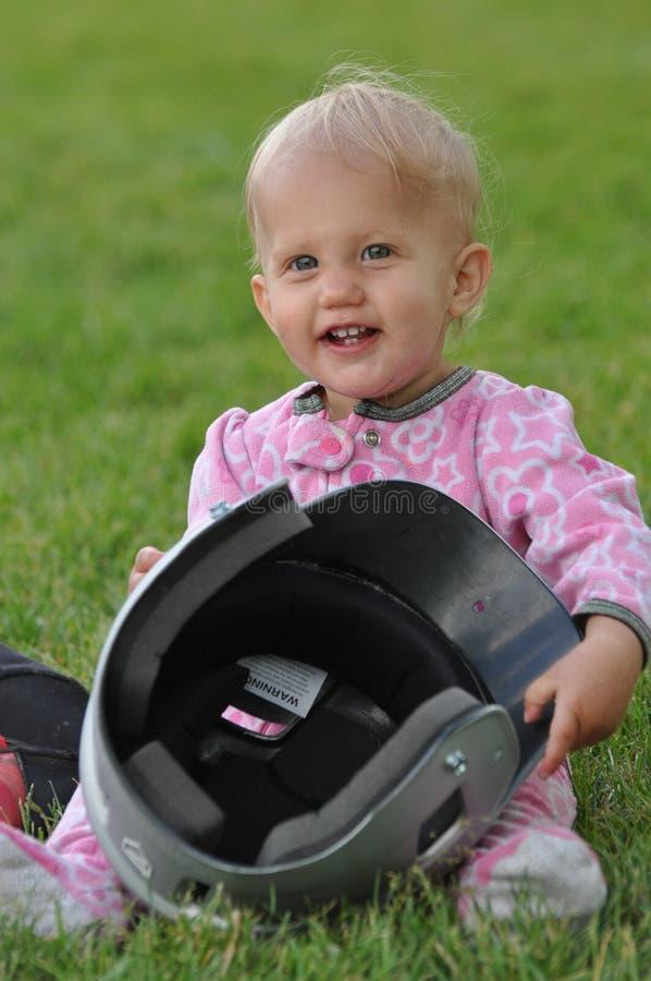 有棒球盔甲的婴孩 图库摄影