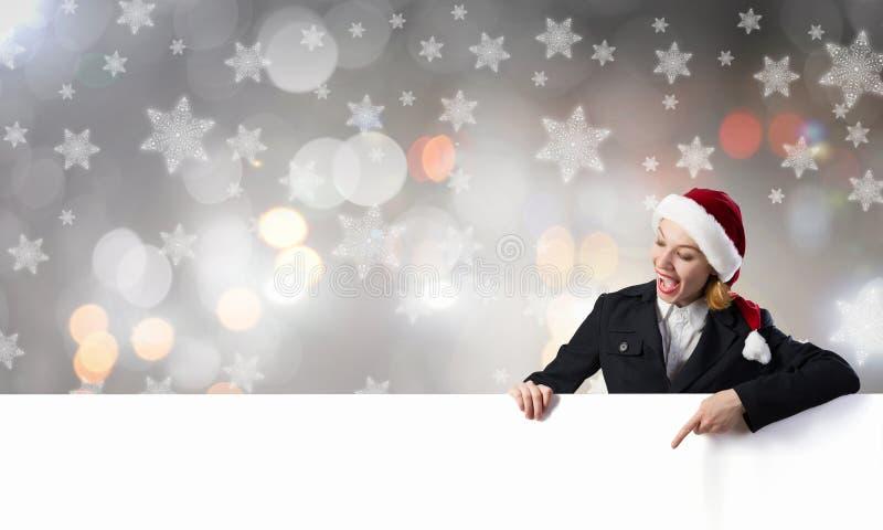 有横幅的圣诞老人妇女 图库摄影